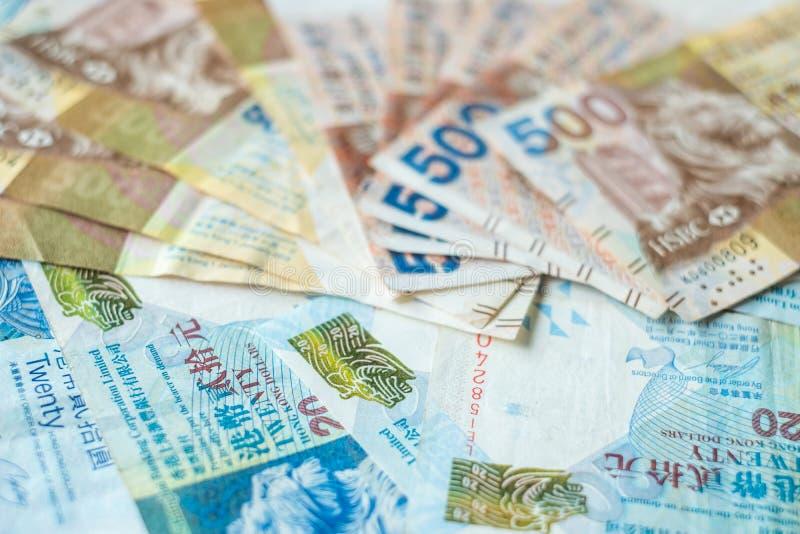 Τραπεζογραμμάτια νομίσματος Χονγκ Κονγκ, δολάρια Χονγκ Κονγκ για την επιχείρηση στοκ φωτογραφία