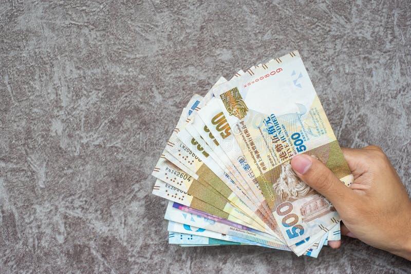 Τραπεζογραμμάτια νομίσματος Χονγκ Κονγκ, δολάρια Χονγκ Κονγκ για την επιχείρηση στοκ εικόνα