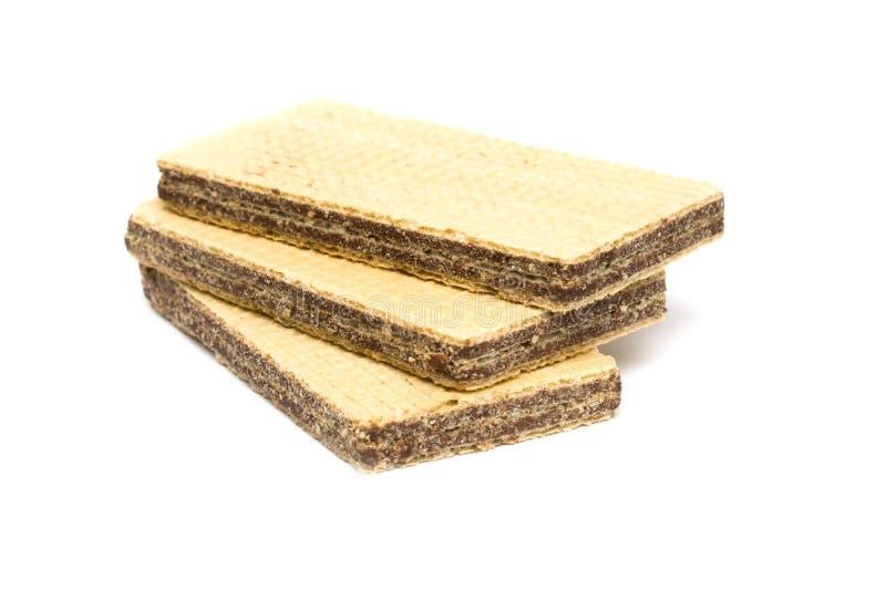 Τρεις γκοφρέτες με τη σοκολάτα σε ένα άσπρο υπόβαθρο στοκ εικόνες