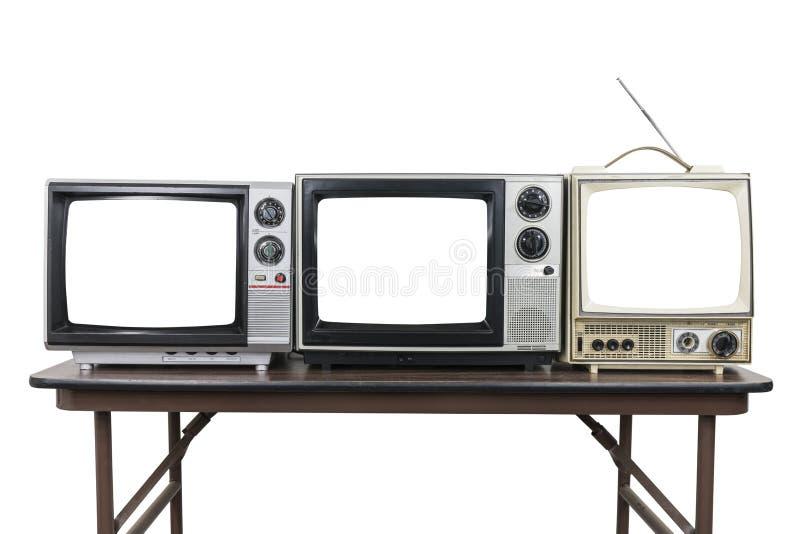 Τρεις εκλεκτής ποιότητας τηλεοράσεις στον πίνακα με τις αποκόπτως οθόνες στοκ εικόνα με δικαίωμα ελεύθερης χρήσης