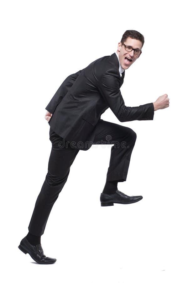 Τρεξίματα επιχειρηματιών στο μαύρο κοστούμι στο λευκό. στοκ εικόνα