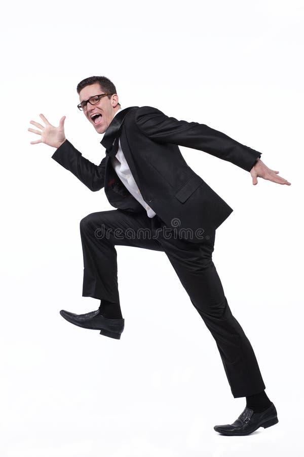 Τρεξίματα επιχειρηματιών στο μαύρο κοστούμι στο λευκό. στοκ εικόνες