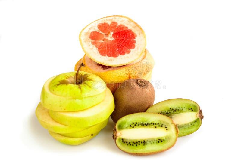 Τροπικό γκρέιπφρουτ νωπών καρπών, μήλο και ένα ακτινίδιο στοκ εικόνα με δικαίωμα ελεύθερης χρήσης