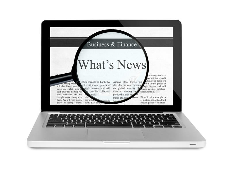 Τροφή ειδήσεων με το lap-top στοκ φωτογραφίες