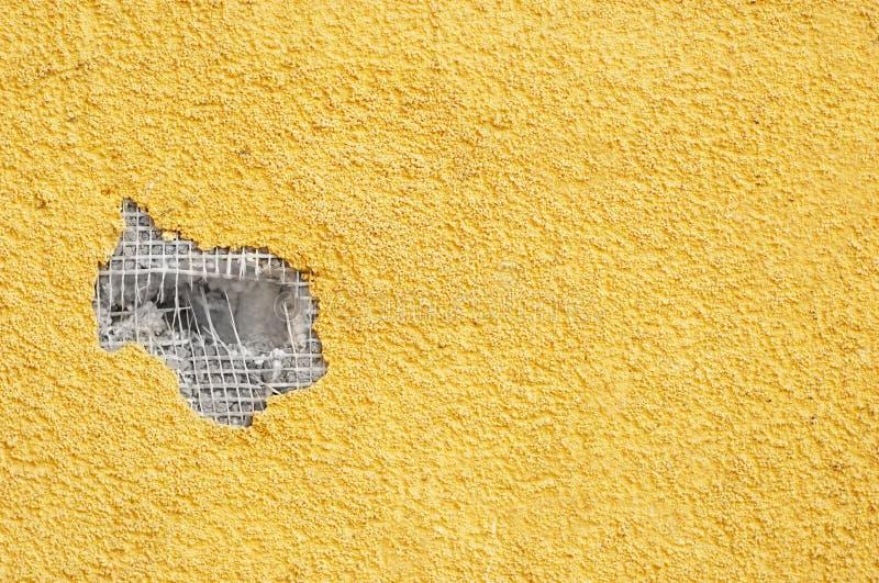 τρυπημένος με διατρητική μηχανή στόκος κίτρινος στοκ εικόνα