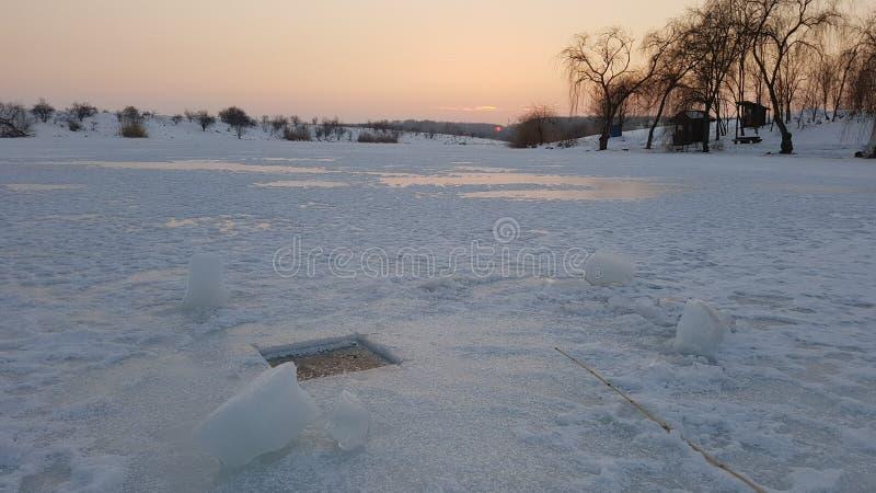 Τρύπα αλιείας πάγου στοκ φωτογραφία