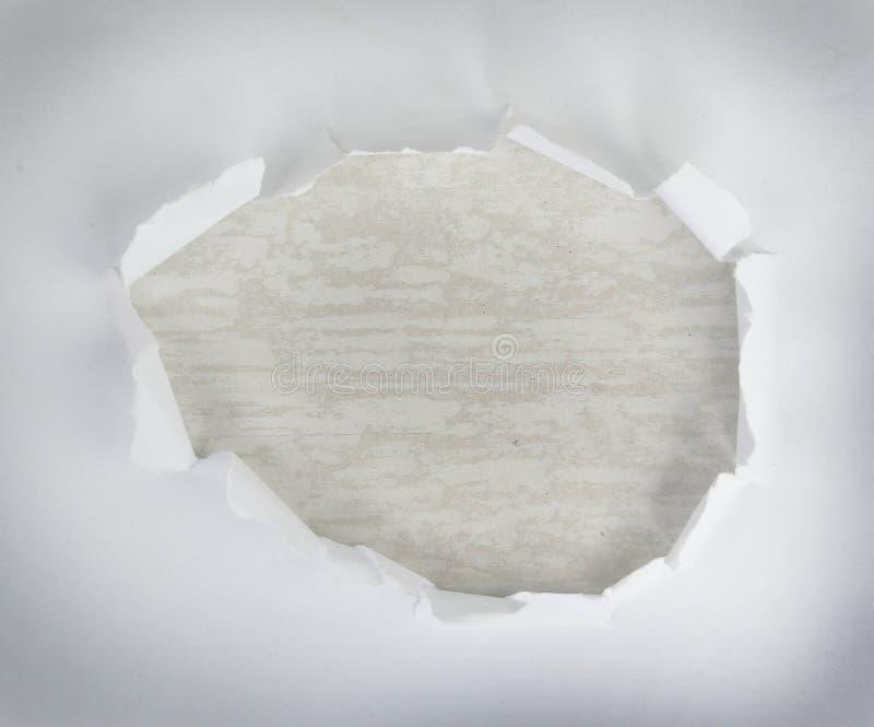 Τρύπα στο έγγραφο στοκ φωτογραφίες με δικαίωμα ελεύθερης χρήσης