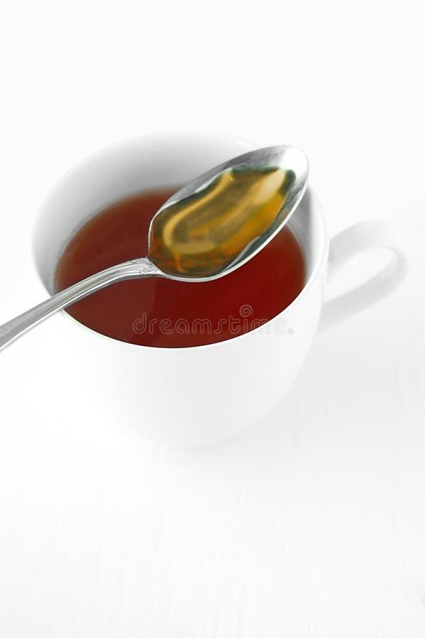 Download τσάι μελιού στοκ εικόνα. εικόνα από άσπρος, τσάι, κουτάλι - 2232167