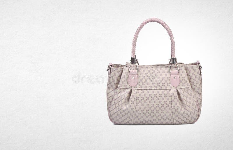 τσάντα ή τσάντα γυναικών σε ένα υπόβαθρο στοκ φωτογραφία με δικαίωμα ελεύθερης χρήσης