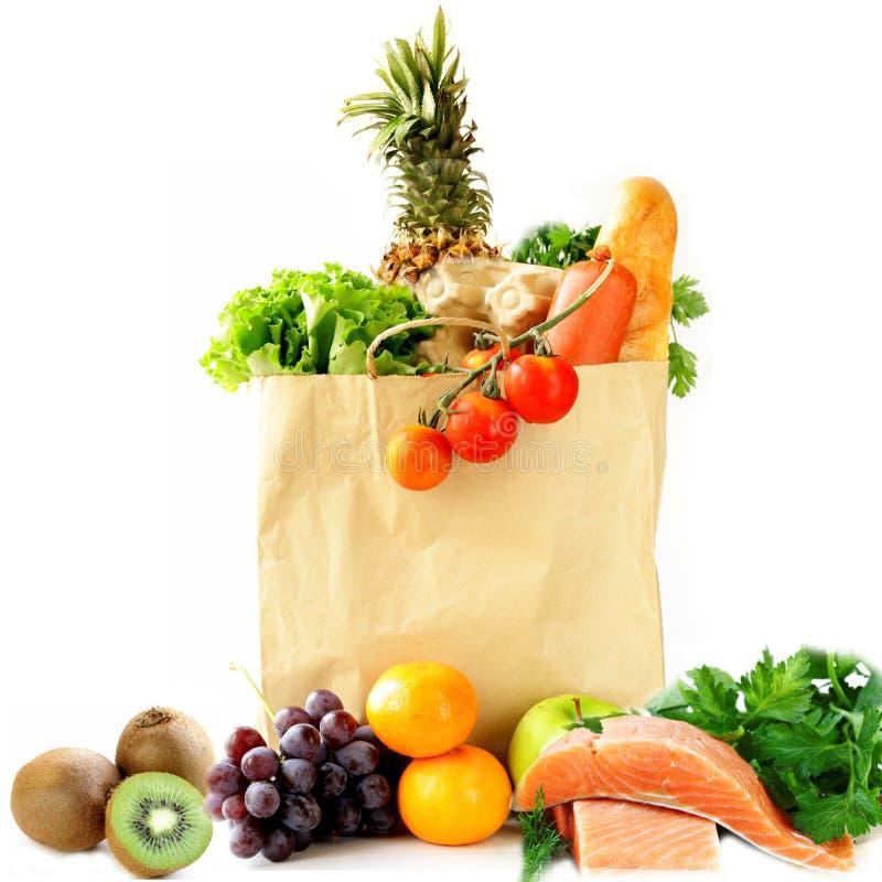Τσάντα αγορών εγγράφου με τα λαχανικά και τα φρούτα, μούρα στοκ εικόνες