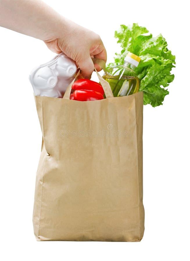 Τσάντα εγγράφου με τα τρόφιμα διαθέσιμα στοκ εικόνες