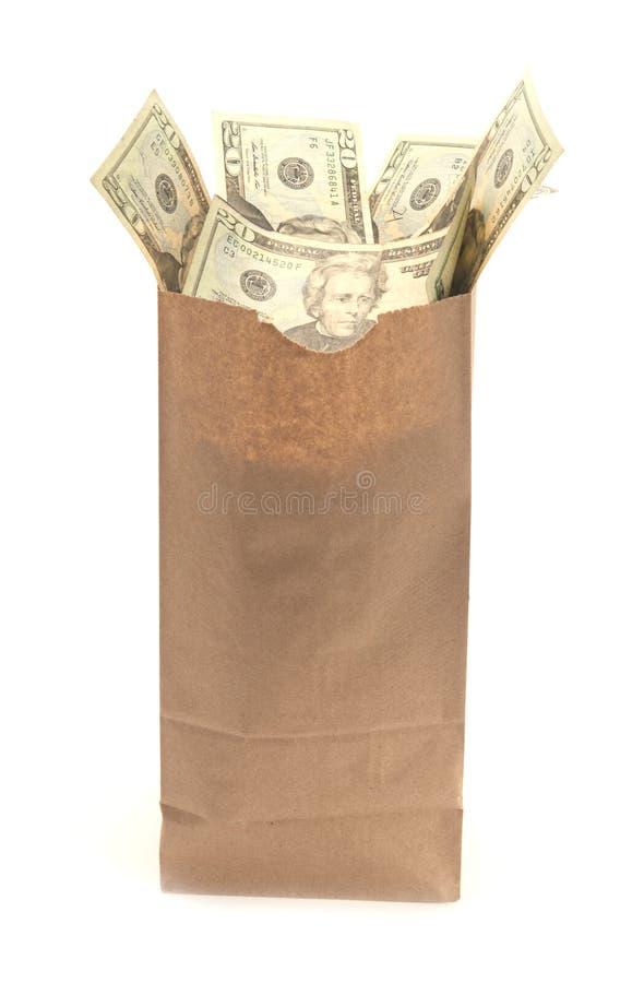 Τσάντα καφετιού εγγράφου με τις Ηνωμένες Πολιτείες λογαριασμοί είκοσι δολαρίων που βγαίνουν από τον στοκ φωτογραφίες με δικαίωμα ελεύθερης χρήσης
