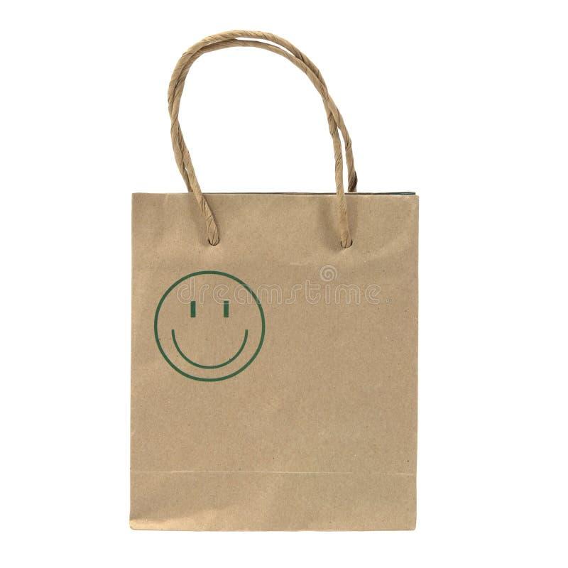 Τσάντα καφετιού εγγράφου το πράσινο πρόσωπο χαμόγελου που απομονώνεται με στο λευκό στοκ εικόνα με δικαίωμα ελεύθερης χρήσης