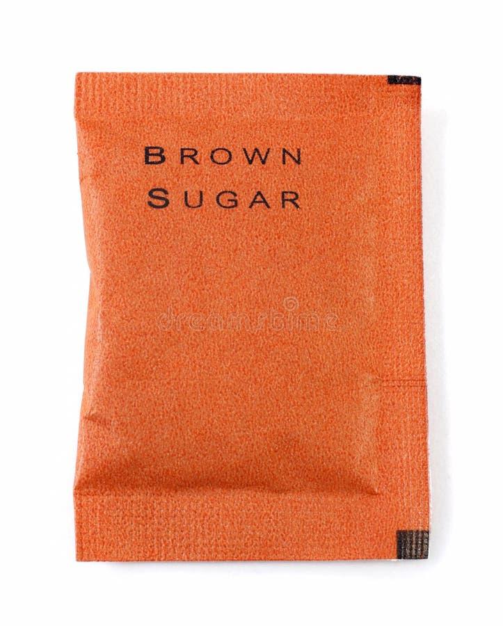 Τσάντα της καφετιάς ζάχαρης στο λευκό στοκ εικόνες με δικαίωμα ελεύθερης χρήσης