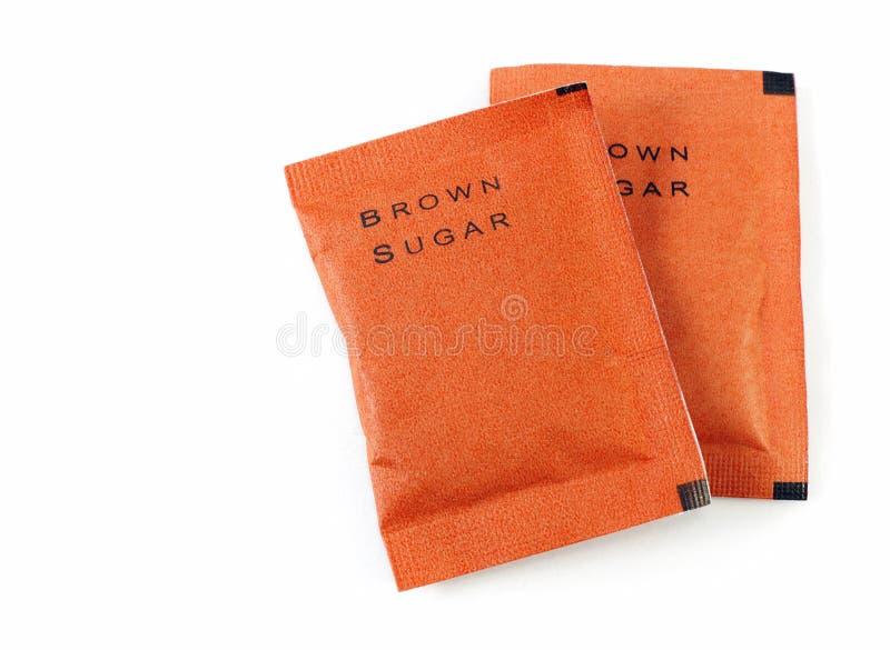 Τσάντα της καφετιάς ζάχαρης στο λευκό στοκ εικόνα με δικαίωμα ελεύθερης χρήσης