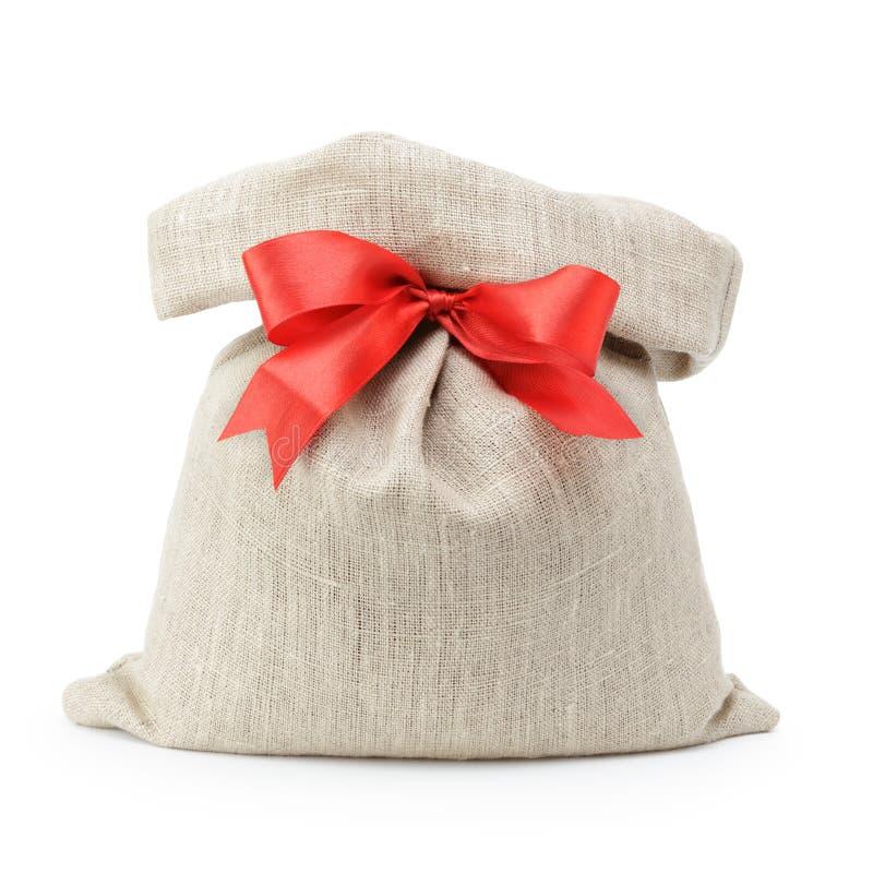 Τσάντα δώρων σάκων με το τόξο κορδελλών στοκ εικόνα