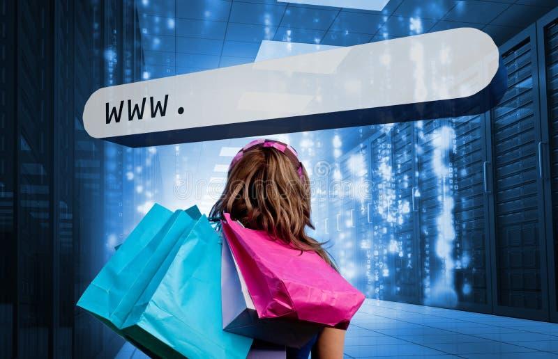 Τσάντες αγορών εκμετάλλευσης κοριτσιών που εξετάζουν το BA διευθύνσεων στοκ εικόνα