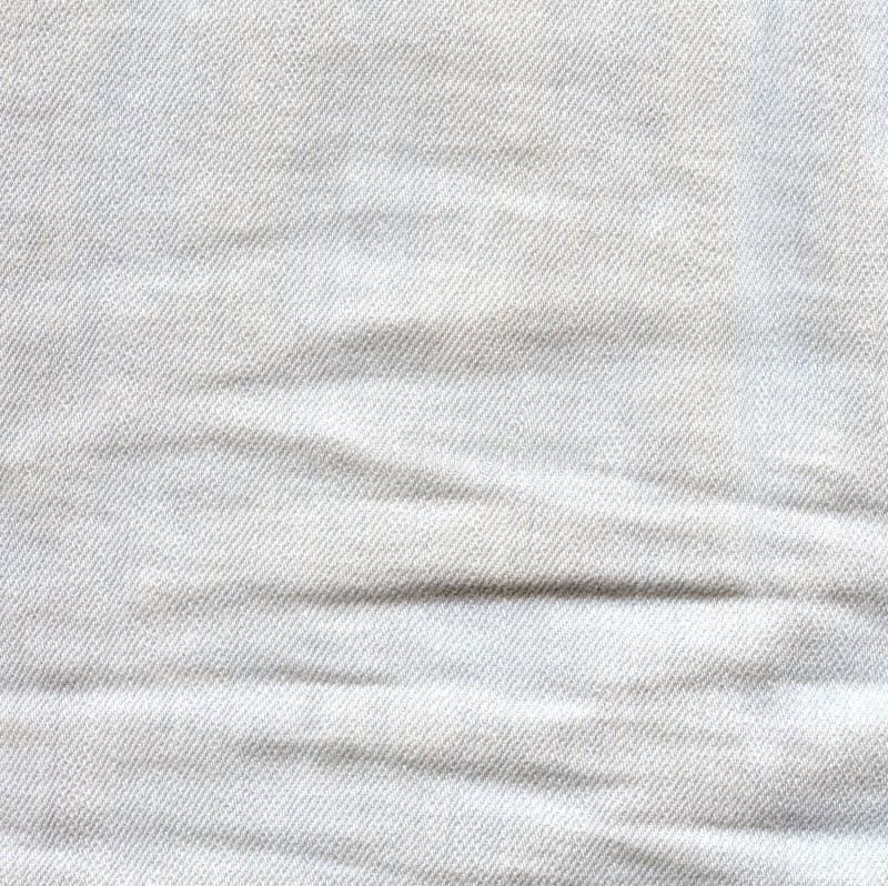 Τσαλακωμένο φως υπόβαθρο τζιν Ζαρωμένη επιφάνεια τζιν Λευκιά GR στοκ εικόνες