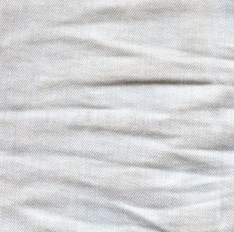 Τσαλακωμένο φως υπόβαθρο τζιν Ζαρωμένη επιφάνεια τζιν Λευκιά GR στοκ φωτογραφίες