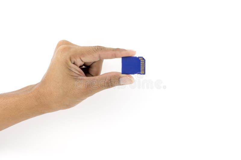Τσιπ καρτών ολοκληρωμένου κυκλώματος SD εκμετάλλευσης χεριών στοκ φωτογραφία με δικαίωμα ελεύθερης χρήσης