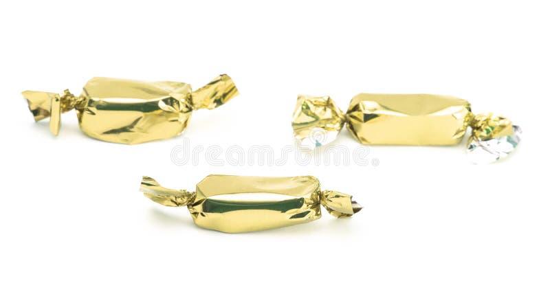 Τυλιγμένη χρυσός καραμέλα στοκ εικόνες