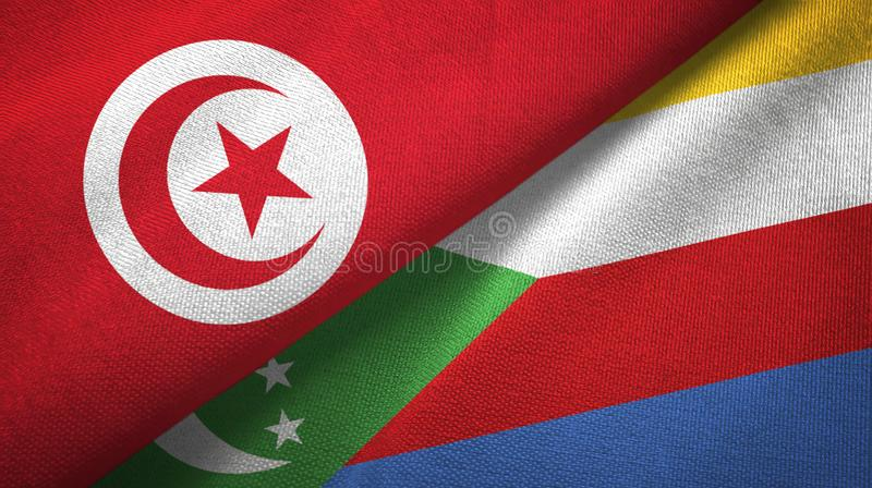 Τυνησία και Κομόρες δύο υφαντικό ύφασμα σημαιών, σύσταση υφάσματος απεικόνιση αποθεμάτων