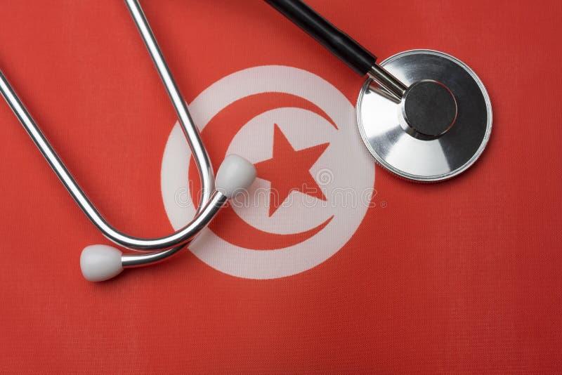 Τυνησιακά σημαία και στηθοσκόπιο Η έννοια της ιατρικής στοκ φωτογραφίες με δικαίωμα ελεύθερης χρήσης