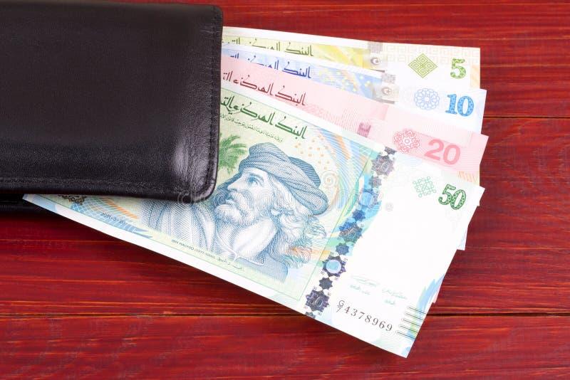 Τυνησιακά χρήματα στο μαύρο πορτοφόλι στοκ φωτογραφίες με δικαίωμα ελεύθερης χρήσης