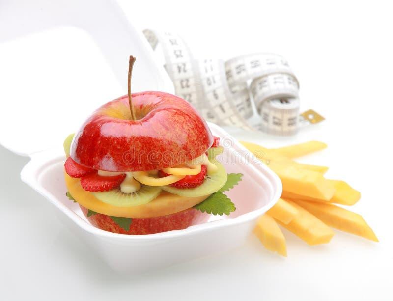Υγιές burger μήλων παίρνει μαζί στοκ εικόνα