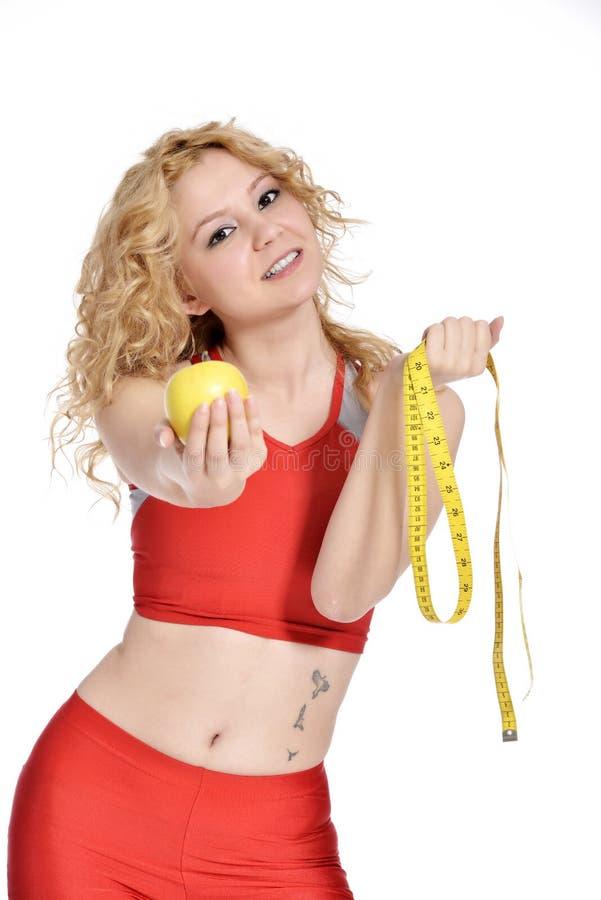 Υγιής τρόπος ζωής - μήλο χεριών γυναικών ικανότητας στοκ εικόνες με δικαίωμα ελεύθερης χρήσης