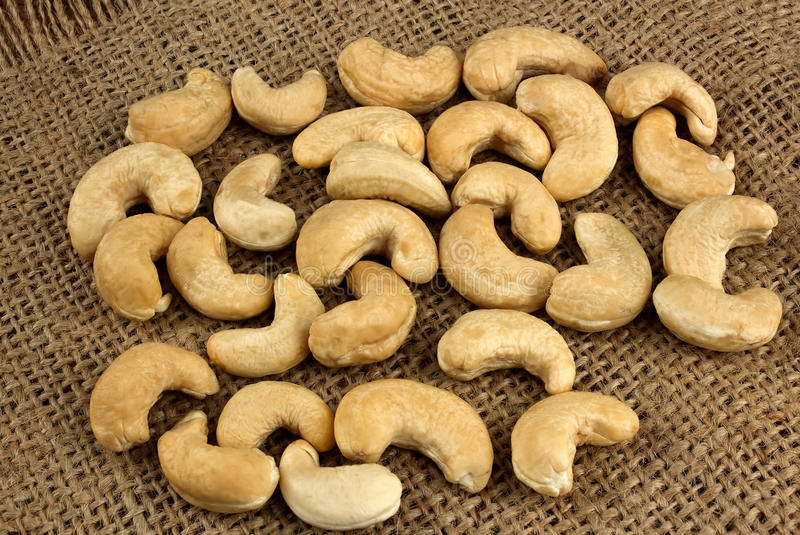 Υγιή τρόφιμα, καρύδια των δυτικών ανακαρδίων ως υπόβαθρο τροφίμων στοκ φωτογραφίες