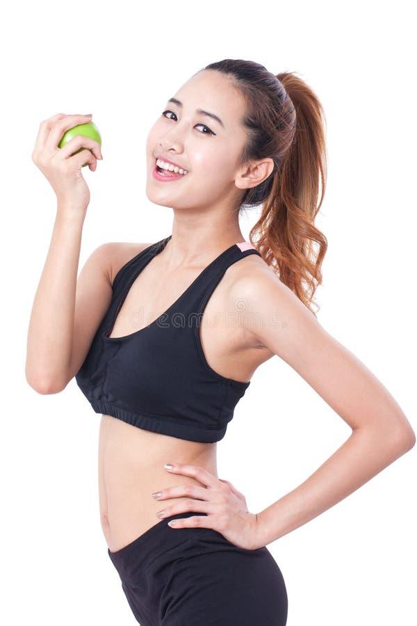 Υγιεινή διατροφή που τρώει το μήλο εκμετάλλευσης γυναικών για τα weightloss στοκ εικόνες