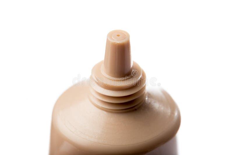 Υγρή κρέμα ιδρύματος makeup που απομονώνεται στο άσπρο υπόβαθρο στοκ εικόνα