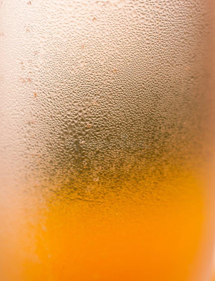 Υγρό κίτρινο γυαλί στοκ εικόνα