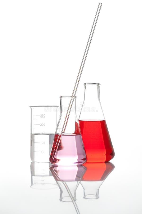 υγρό κόκκινο γυαλιού φιαλών στοκ φωτογραφία με δικαίωμα ελεύθερης χρήσης