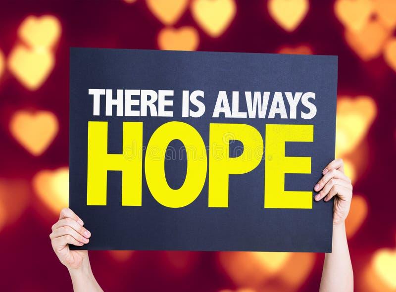 Υπάρχει πάντα κάρτα ελπίδας με το υπόβαθρο καρδιών bokeh στοκ εικόνα