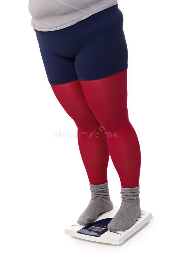 υπέρβαρη γυναίκα κλίμακας στοκ εικόνες με δικαίωμα ελεύθερης χρήσης