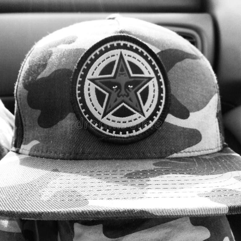 Υπακούστε το καπέλο στοκ εικόνες