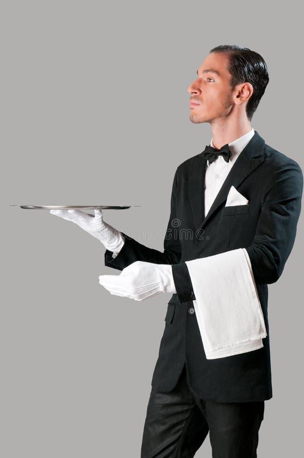 υπεροπτικός σερβιτόρος στοκ εικόνες