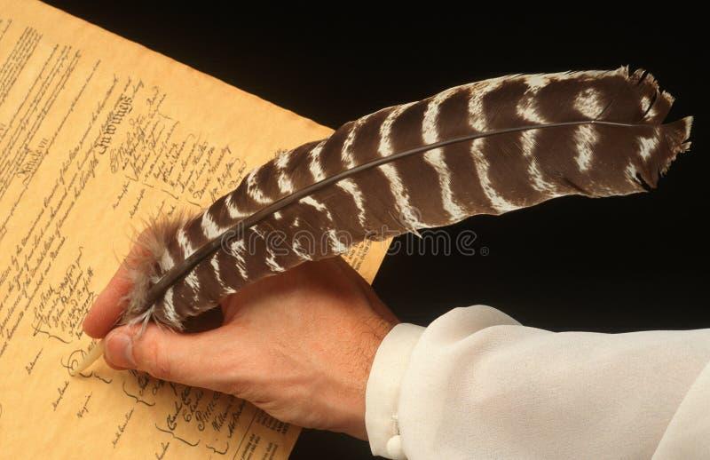 Υπογραφή με την πέννα καλαμιών στοκ φωτογραφία με δικαίωμα ελεύθερης χρήσης