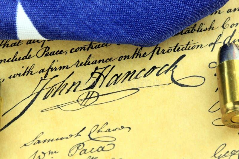 Υπογραφή του John Hancock - πυρομαχικά στο αμερικανικό σύνταγμα στοκ φωτογραφία