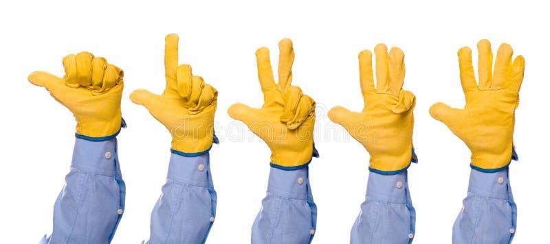 Υπολογισμός μηχανικών κατασκευής με τα δάχτυλα από το ένα έως πέντε στοκ εικόνες