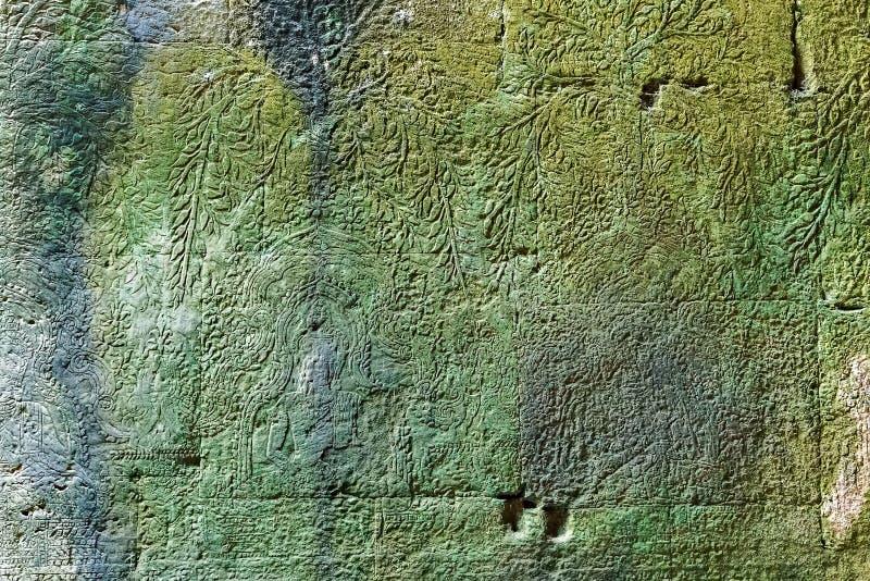 Υπόβαθρο αγαλμάτων bas-ανακούφισης του Khmer πολιτισμού σε Angkor Wat, έκκεντρο στοκ εικόνα