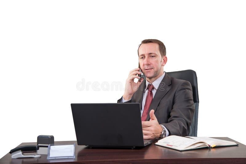 Υπόβαθρο με το διευθυντή στο γραφείο, στο κτήριο τελευταίων ορόφων, στοκ φωτογραφία