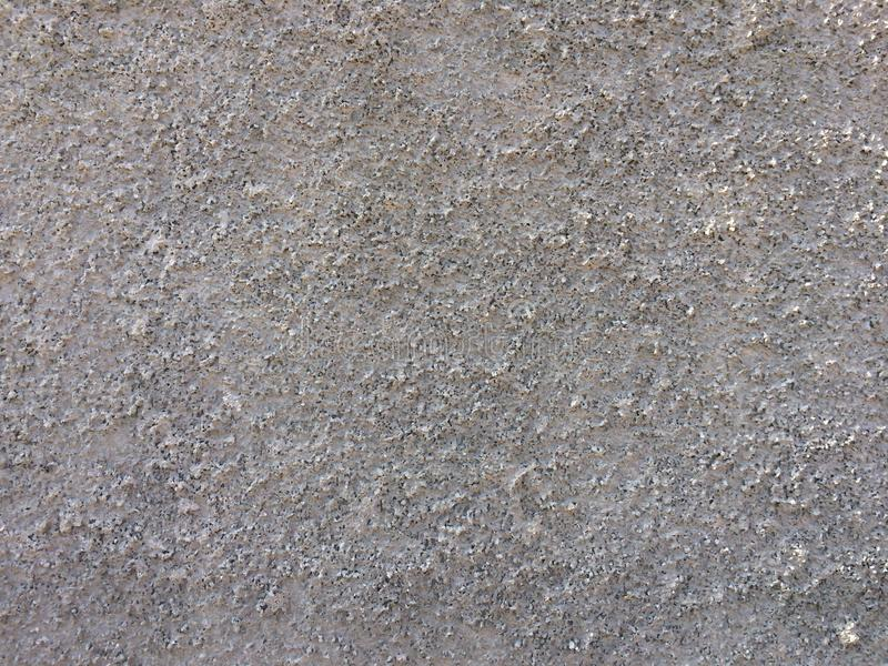Υπόβαθρο σύστασης ως γκρίζο τοίχο που ψέκασε με τα μικρά μόρια πετρών στοκ φωτογραφία με δικαίωμα ελεύθερης χρήσης