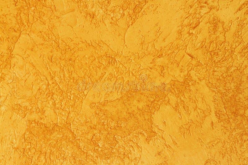 Υπόβαθρο της χρυσής κατασκευασμένης επιφάνειας Χρυσή σύσταση για το υπόβαθρο σχεδίου και Ιστού Λαμπρή χρυσή επιφάνεια του συμπαγο στοκ φωτογραφίες με δικαίωμα ελεύθερης χρήσης