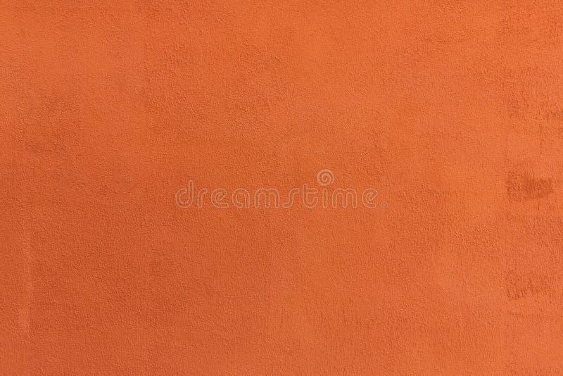 Υπόβαθρο του εκλεκτής ποιότητας πορτοκαλιού τσιμέντου χρώματος στοκ εικόνα