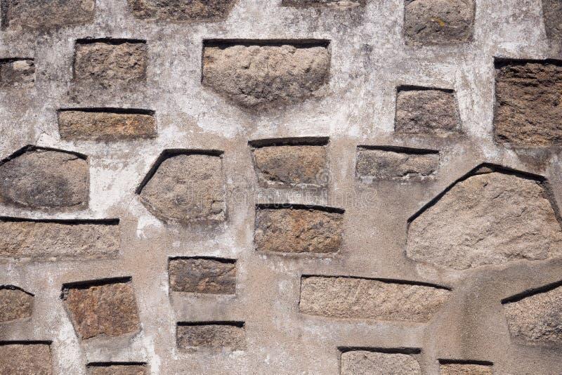 Υπόβαθρο του παλαιού τοίχου πετρών με τα γεωμετρικά σχέδια στοκ φωτογραφία με δικαίωμα ελεύθερης χρήσης
