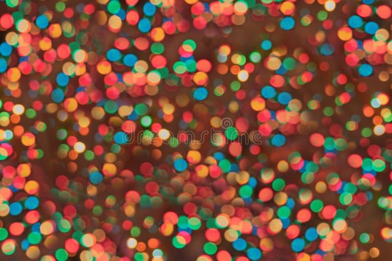 Υπόβαθρο Χριστουγέννων με τους λαμπρούς ελαφριούς κύκλους στοκ φωτογραφία με δικαίωμα ελεύθερης χρήσης