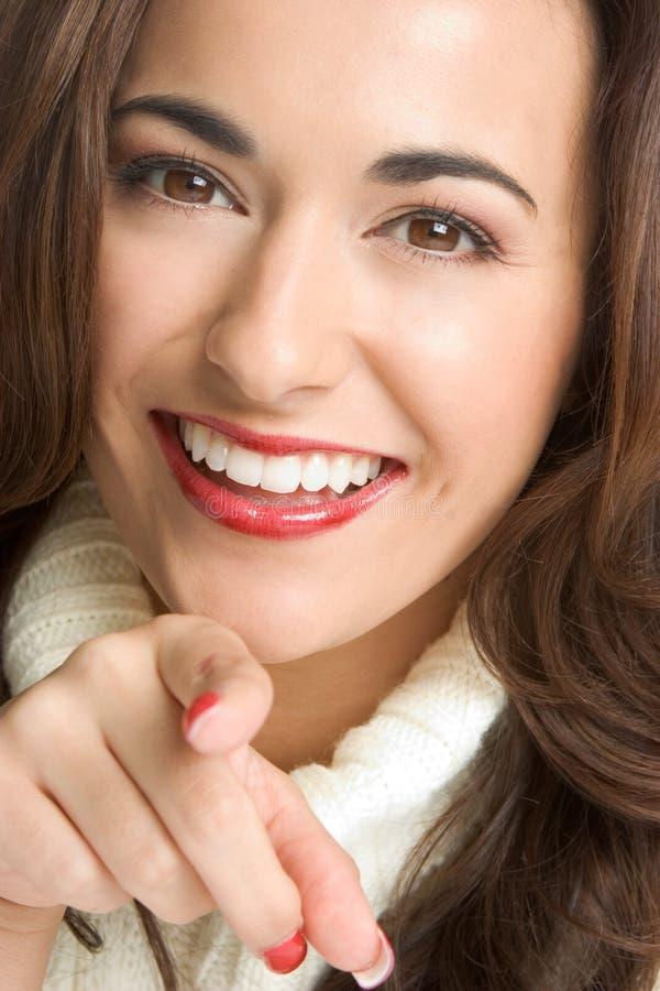υπόδειξη της χαμογελώντας γυναίκας στοκ εικόνες με δικαίωμα ελεύθερης χρήσης